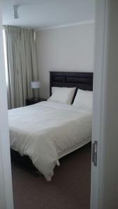 Cama o camas de una habitación en Austral Rentahome Galvarino