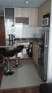 Una cocina o zona de cocina en Austral Rentahome Galvarino