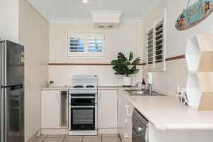 A kitchen or kitchenette at Lennox Head Beachfront Apartments