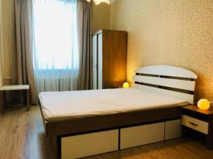 A bed or beds in a room at Kizhi