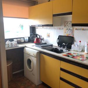 A kitchen or kitchenette at Gilcomstoun Land Apartment