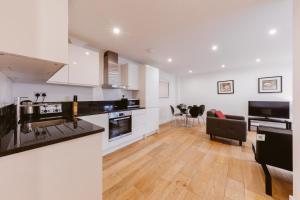 Küche/Küchenzeile in der Unterkunft Rosea apartment