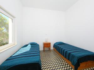 A bed or beds in a room at Villa Casa Da Guarda