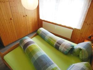 Ein Bett oder Betten in einem Zimmer der Unterkunft Apartment Résidence Sonnegg (Vuilleumier)