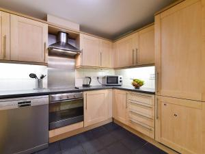 A kitchen or kitchenette at Apartment London House