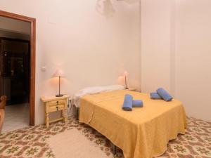 Llit o llits en una habitació de Holiday Home Triana