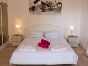 A bed or beds in a room at Villa Whitehouse