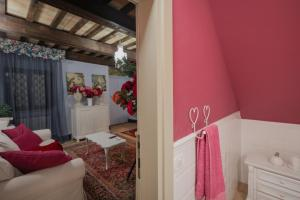 A bed or beds in a room at Casa di Anita