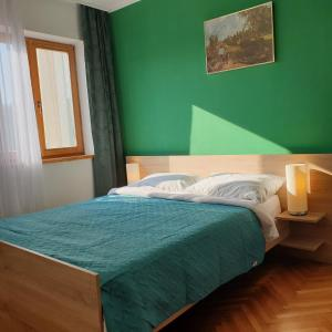 A bed or beds in a room at Apartments Šeherzada