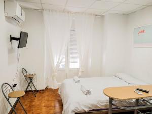 Tempat tidur dalam kamar di Estudio Calle Murillo