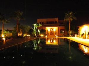 The swimming pool at or near La Villa Des Golfs