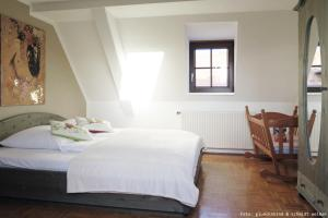 """A bed or beds in a room at Ferienwohnung """"Oha"""""""