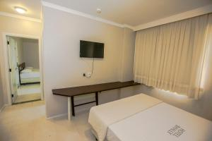 A bed or beds in a room at Apart Hotel Bhally INN