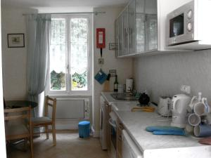 A kitchen or kitchenette at Holiday Home La Jonquiere