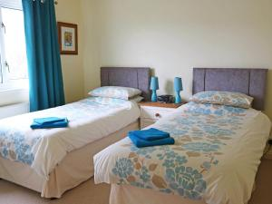 A bed or beds in a room at Holiday Home Teangue