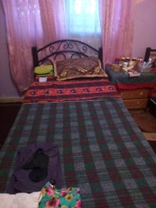 A bed or beds in a room at Zeinab house