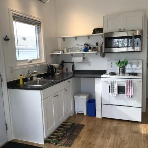 A kitchen or kitchenette at Twin Birch Suites and Cottages