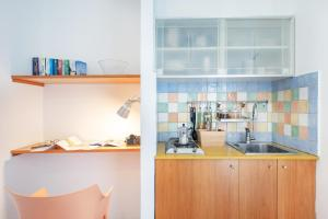 A kitchen or kitchenette at Gioia 37 Apartments