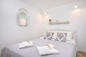 Un ou plusieurs lits dans un hébergement de l'établissement La vecchia bottega del Nonno - Corfu