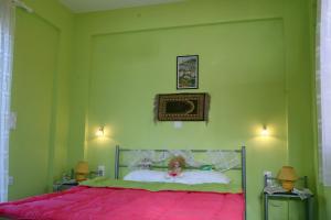 Ένα ή περισσότερα κρεβάτια σε δωμάτιο στο Evaland Traditional Houses