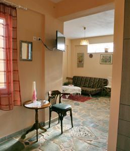 Χώρος καθιστικού στο Evaland Traditional Houses