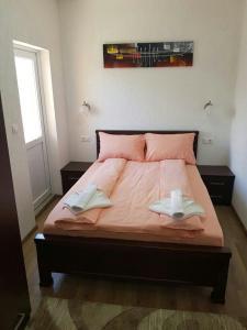 Postel nebo postele na pokoji v ubytování Apartmani Srećko
