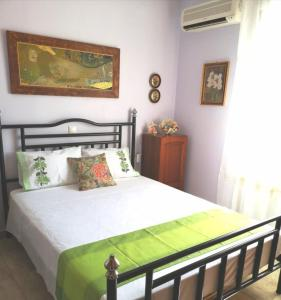 A bed or beds in a room at Katerina's Garden House