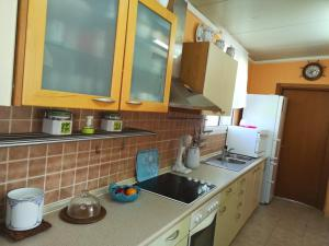 A kitchen or kitchenette at Katerina's Garden House