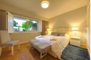 A bed or beds in a room at Victory Village 6B
