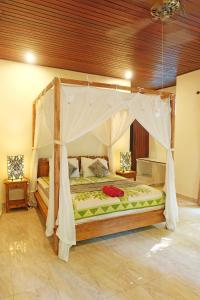 A bed or beds in a room at Rumah Kelinci