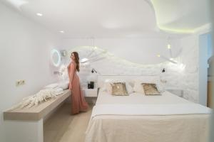 A bed or beds in a room at Spiros