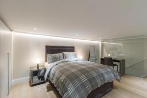 Ein Bett oder Betten in einem Zimmer der Unterkunft One Bedroom luxury Apartment