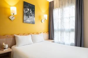 Un ou plusieurs lits dans un hébergement de l'établissement Aparthotel Adagio Marne La Vallée - Val d'Europe