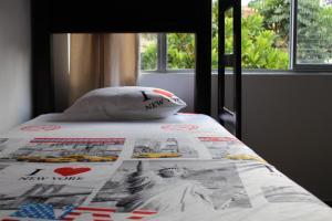 A bed or beds in a room at Apartamentos Excelente Ubicación