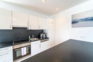 A kitchen or kitchenette at Margareten Apartments