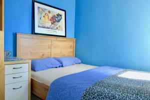 A bed or beds in a room at Apartment Port Forum