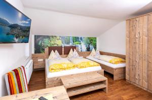 A bed or beds in a room at Appartement Pension Albert