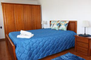 A bed or beds in a room at Casa do Facho