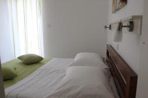 Postel nebo postele na pokoji v ubytování Apartments Adria
