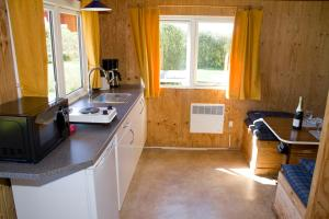 A kitchen or kitchenette at Ballum Camping
