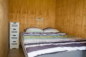 A bed or beds in a room at Ballum Camping