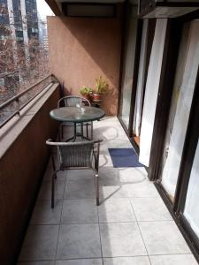 Un balcón o terraza de Encomenderos Apart Hotel