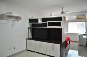 Een TV en/of entertainmentcenter bij Confort Flat 2