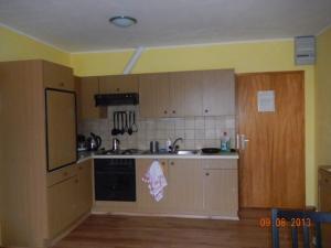 A kitchen or kitchenette at Appartments Kastanienbaum
