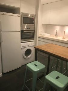 A kitchen or kitchenette at Apartment Luzan