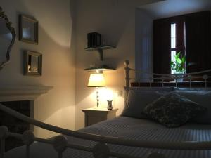 A bed or beds in a room at Casa Aurora