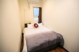 A bed or beds in a room at Condominium Palace Resort Chatan A / Vacation STAY 28349