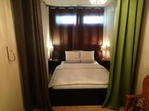 Ein Bett oder Betten in einem Zimmer der Unterkunft Apartment Nord