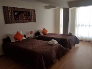 Cama o camas de una habitación en Kintu Apart-Hotel