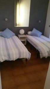 A bed or beds in a room at Ancora